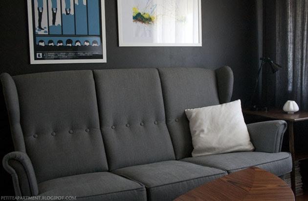 grey strandmon ikea sofa in living room with black grey walls mid century modern inspiration