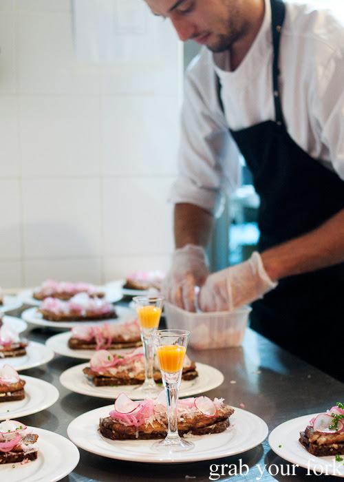 Chef plating up Sol over Gudhjem at Restaurant Dansk for A Danish Food Trail