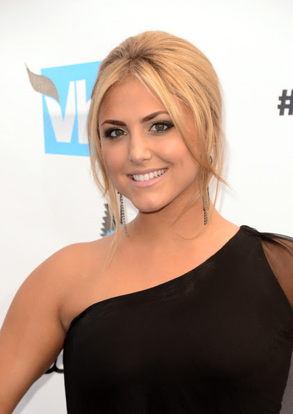 Actress Cassie Scerbo arrives at the 2012 Do Something Awards at Barker Hangar on August 19, 2012 in Santa Monica, California.