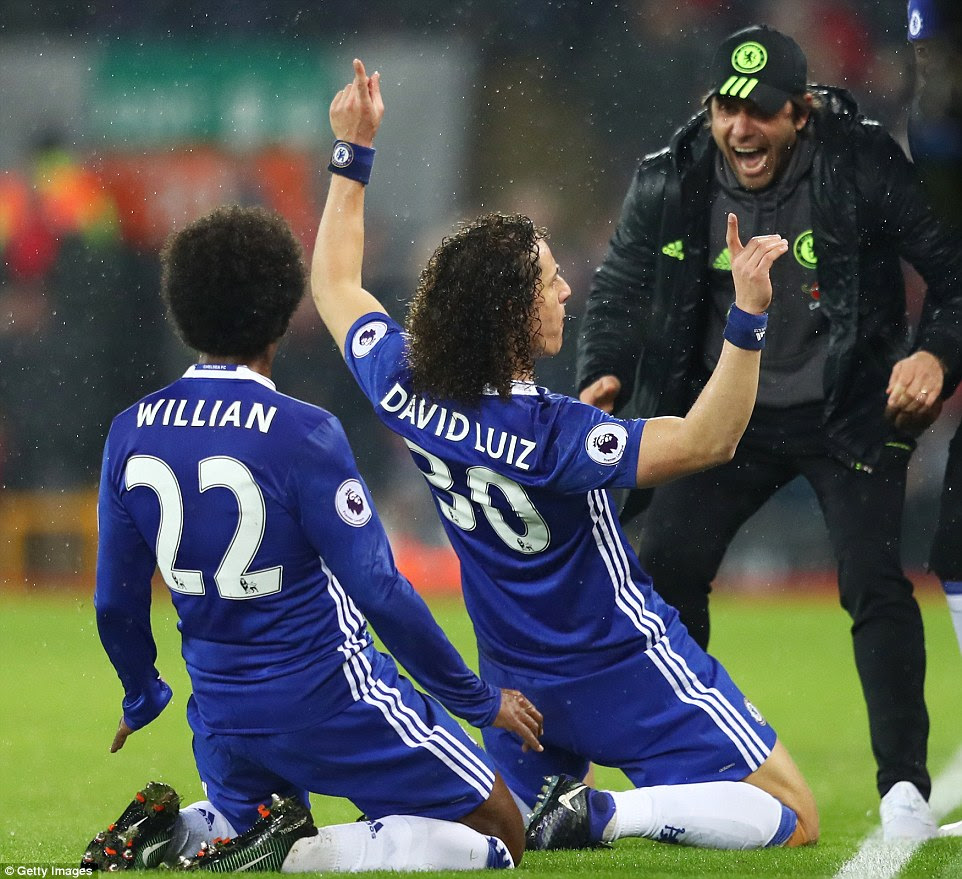 The Brazil international, who is in his second spell with Chelsea, celebrates in front of Antonio Conte after scoring