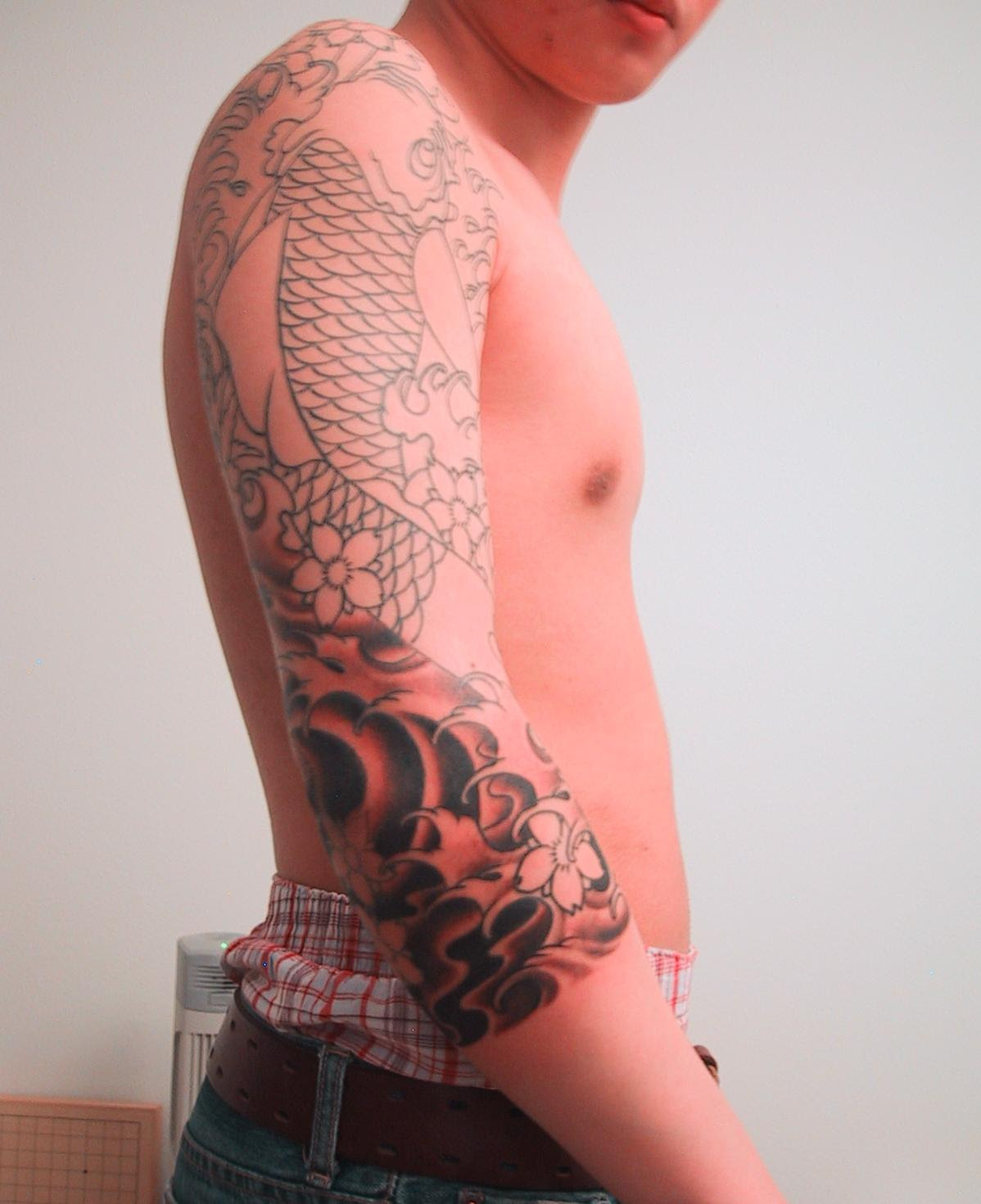 Color Ink Japanese Tattoo On Man Right Sleeve