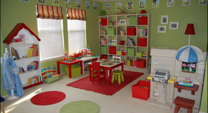 Avocado green and apple red child's playroom with blue accents
