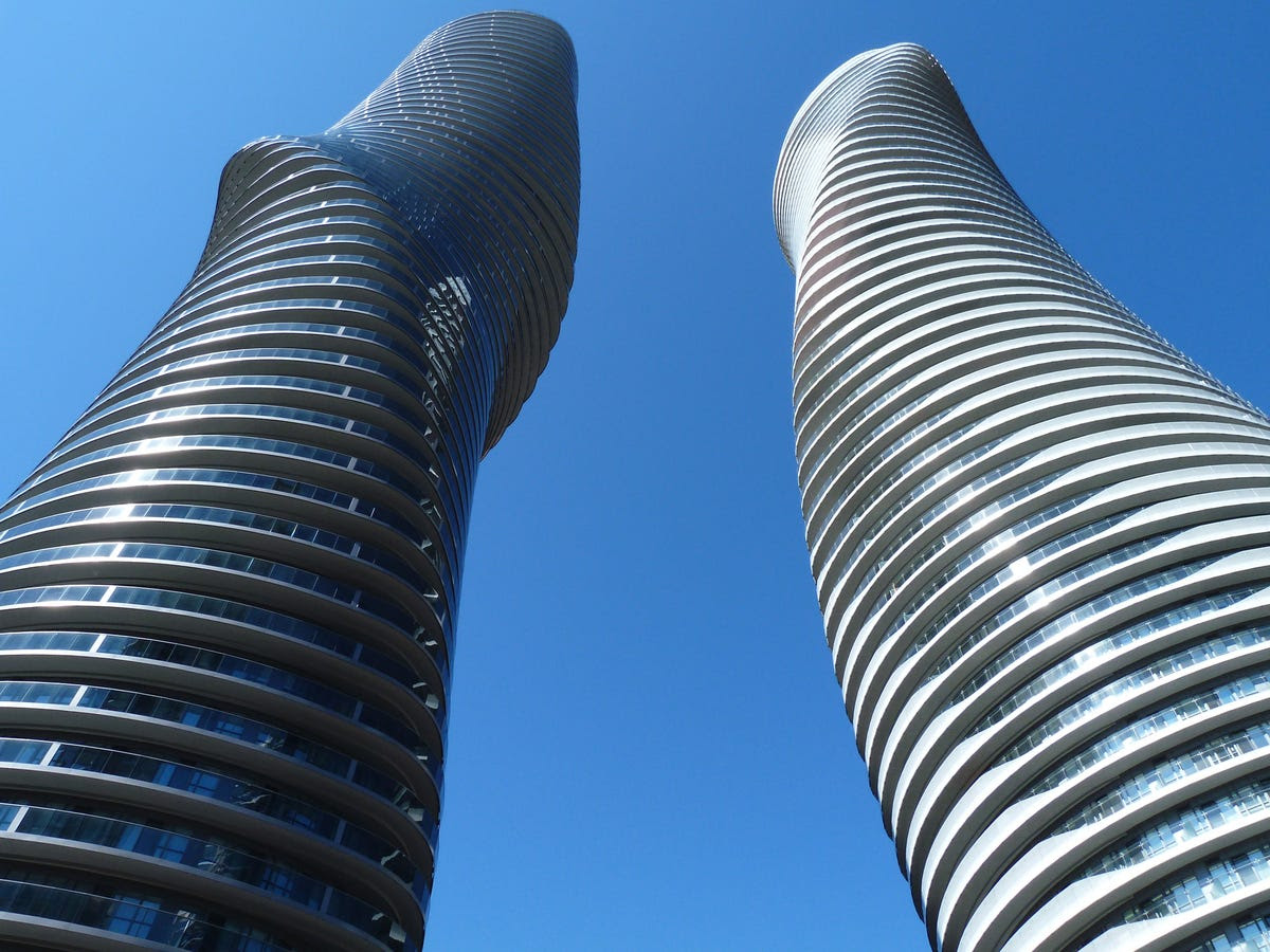 "#1 ABSOLUTE WORLD TOWERS — This year's winner, Canada's Absolute World Tower 1 & 2 are a part of a residential tower complex. Due to their curved shape and the fact that no floor appears the same, the two towers were nicknamed ""Marilyn Monroe."""