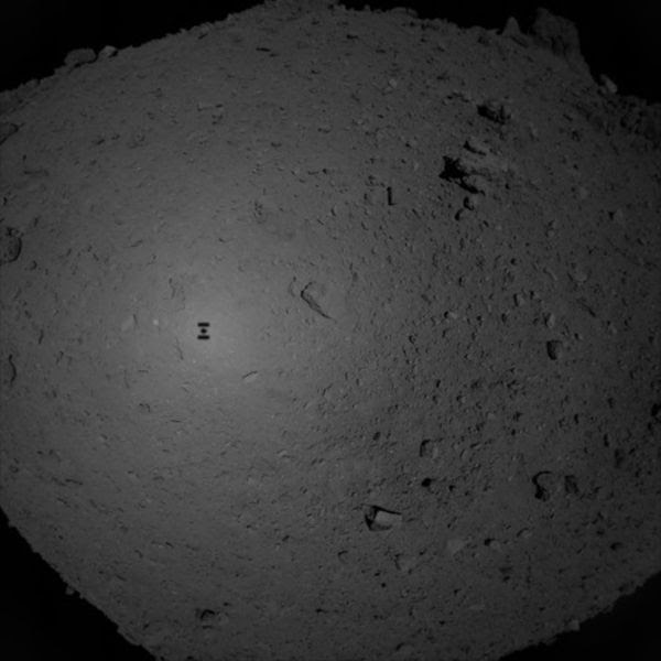 Hayabusa2's shadow is visible on Ryugu's surface as the spacecraft descended towards the asteroid to collect its first rock samples...on February 21, 2019 (Pacific Time).