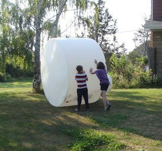 Kids pushing water tank