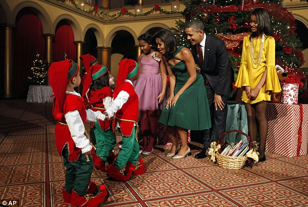 Christmas cheer: The children in their adorable costumes delighted the Obamas during a traditional celebration for the President and his family