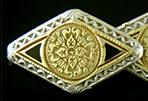 Elegantly engraved gold and platinum cufflinks. (J9283)