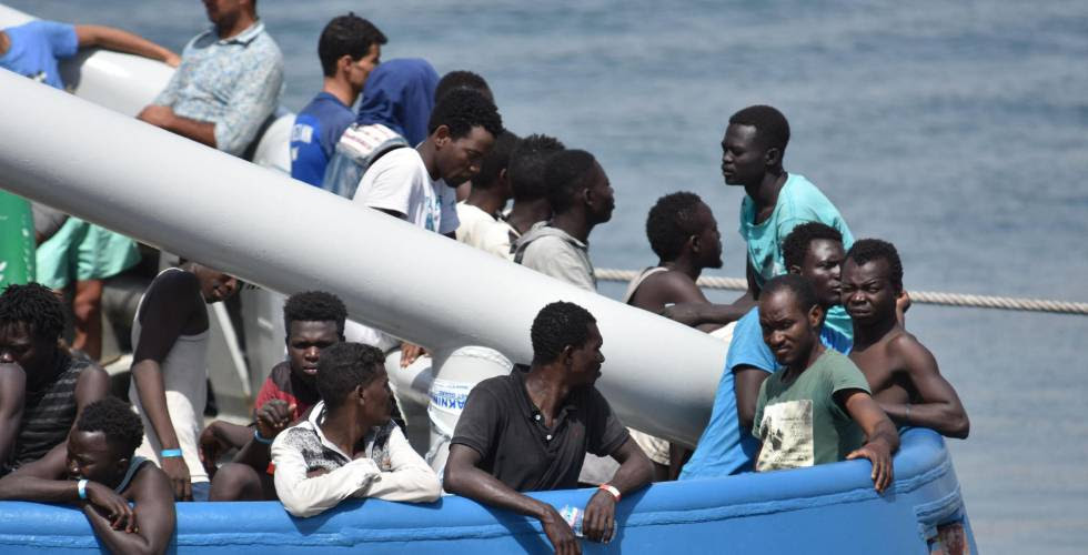 Rescued migrants wait to disembark in Catania, Italy.