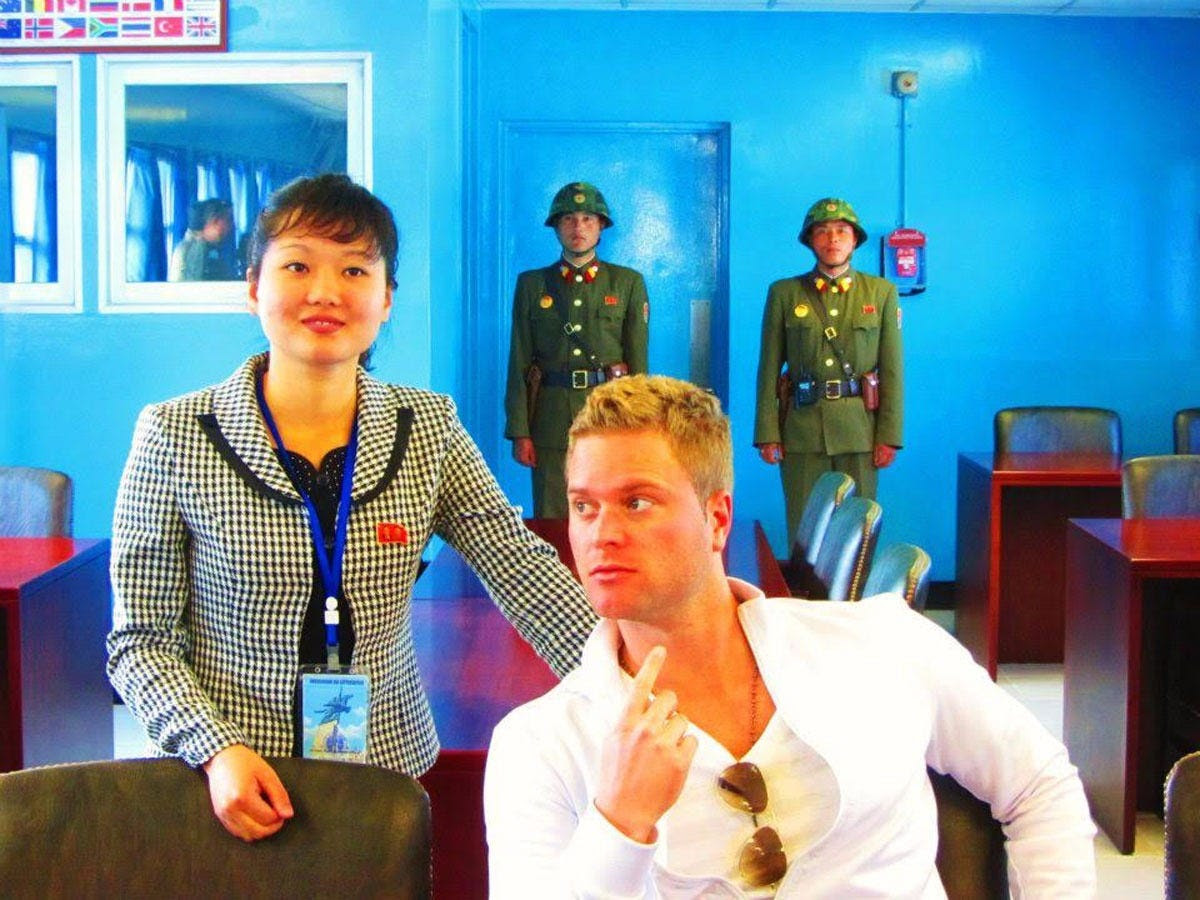 Despite this, they were able to talk the guards into allowing them inside one of the blue huts. South Korea begins just behind the last two guards pictured here behind Justin.
