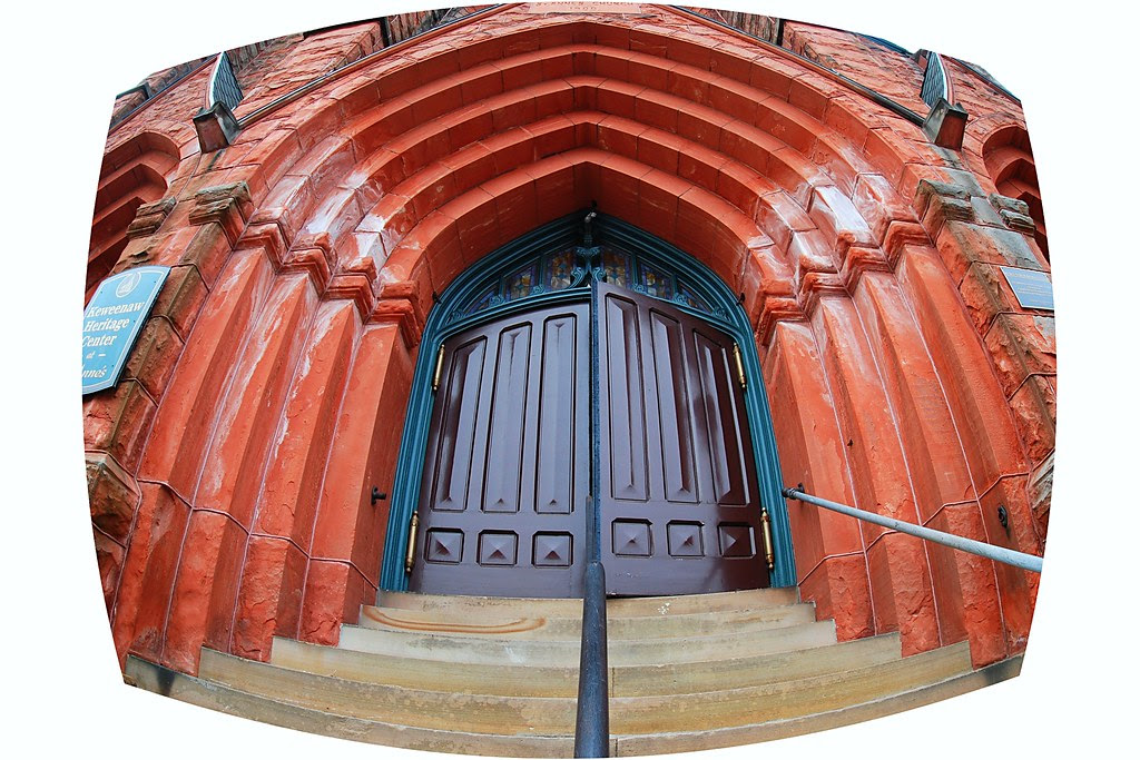 A multi-coursed doorway made of red sandstone.