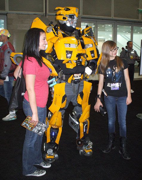Even fake Bumblebee can get the girls (with the one to Bee's right looking KINDA like Megan Fox) at Stan Lee's Comikaze Expo in downtown Los Angeles, on November 2, 2013.