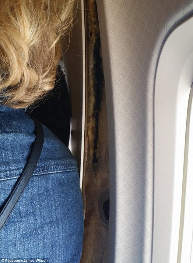 An American Airlines spokesman says a blown air duct is being investigated as the possible cause