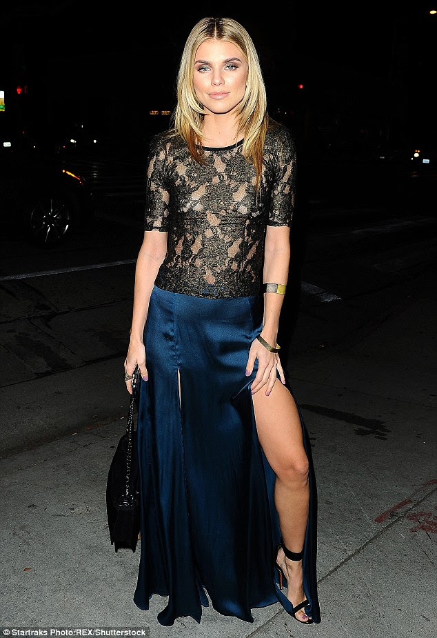 Lesson in leg-bombing: AnnaLynne, 28, flashed a whole lot of leg in her slashed maxi skirt as she headed to the event