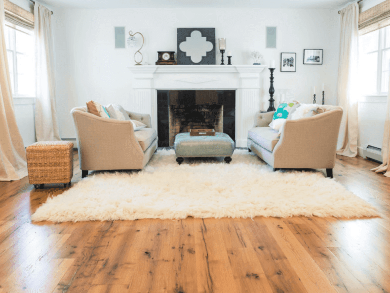 Wide plank reclaimed oak flooring in a traditional living room