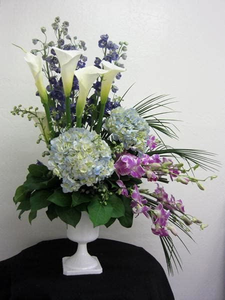 Asymmetrical design with various flowers & greenery