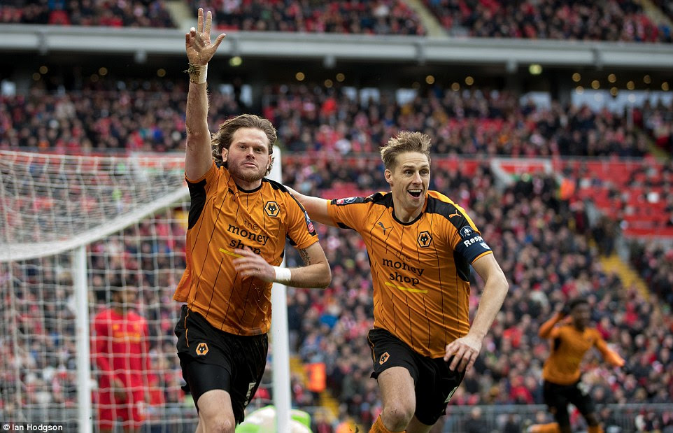 The Wolves defender celebrates in front of the Kop after stunning the home side inside the opening 60 seconds