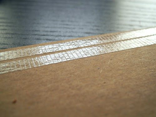 Lay strips of adhesive on chipboard edges
