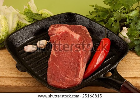 stock photo : a french entrecote / steak / in pan, griddle