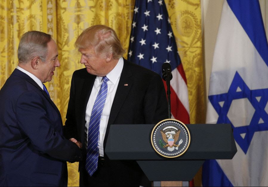 President Donald Trump (R) greets Israeli Prime Minister Benjamin Netanyahu at a joint news.