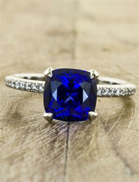 Blue sapphire cushion solitaire engagement ring with