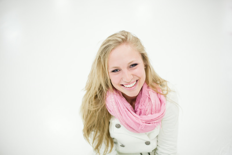 A senior photo session with pictures taken at Riverview Ice House in Downtown Rockford, IL. Skating photos were taken at the ice skating rink during summer hours. Photo by Mindy Joy Photography