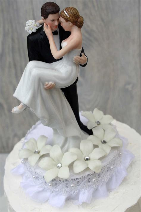 Stephanotis Groom Holding the Bride Wedding Cake Topper