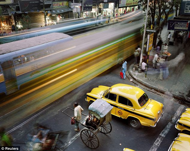 Taxis waiting at a railway crossing in Calcutta were taken by Martin Roemers, a Panos Pictures photographer based in the Netherlands, winning him 1st Prize Daily Life Stories category