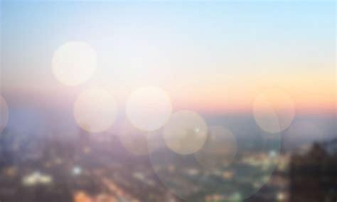 Blurred sunrise over city background   1designshop