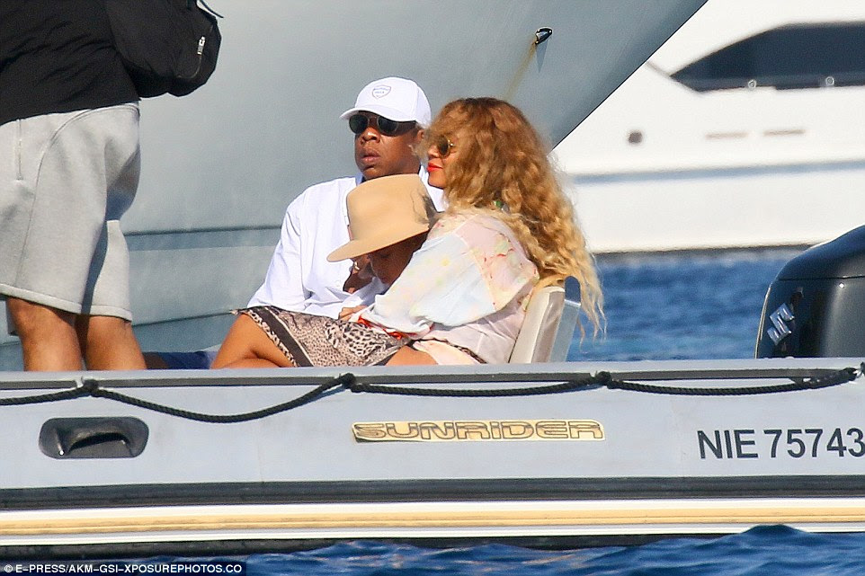 Mumy's little girl: Beyonce cuddled her little daughter as the dinghy pulled away from the yacht