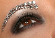 Beautiful smokey brown eye shadow with a bejeweled eye brow.