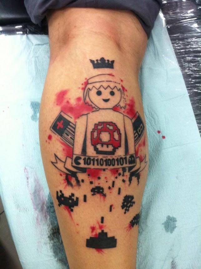 Game Tattoo By Mel Wink Tattoomagz