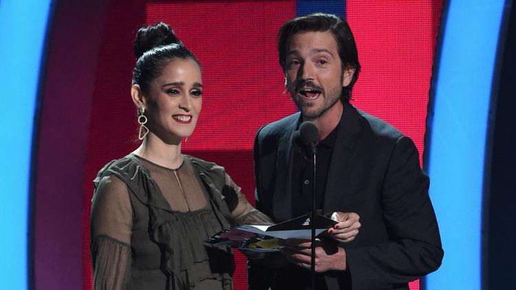 Julieta Venegas, left, with Diego Luna, who called on Latinos to fight discrimination.