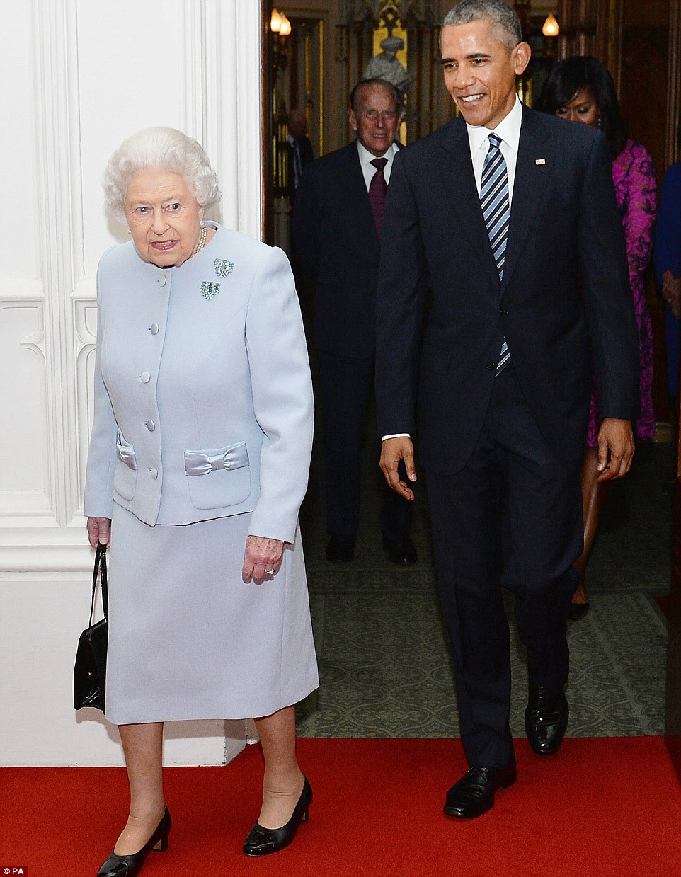 Going in: Mr Obama and the Queen entering the Oak Room at the castle to pose for photos before their lunch