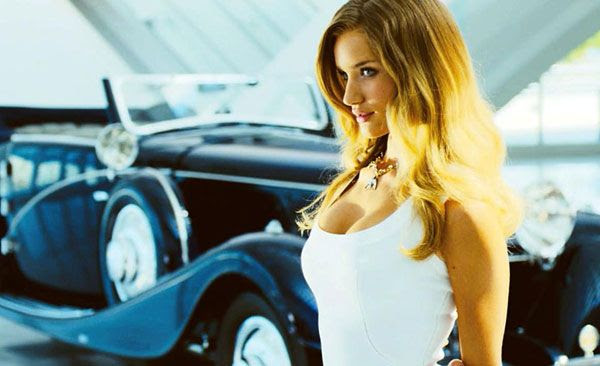Carly (Rosie Huntington-Whiteley) is about to mingle with nice cars that transform into giant alien robots in TRANSFORMERS: DARK OF THE MOON.