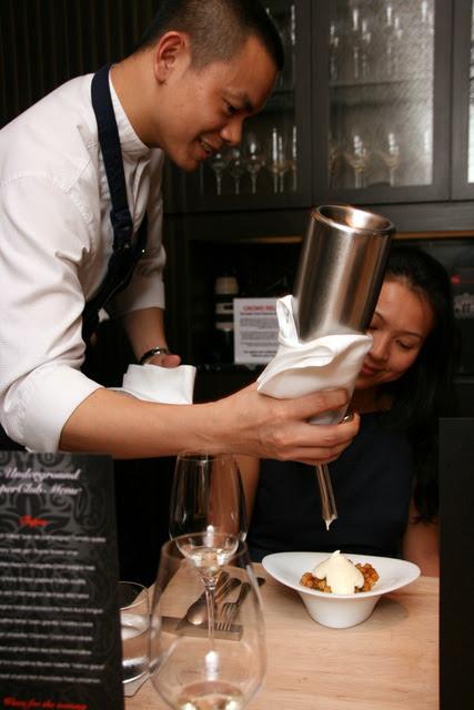 Andre dispensing foam of mashed potato onto the Spanish Omelette