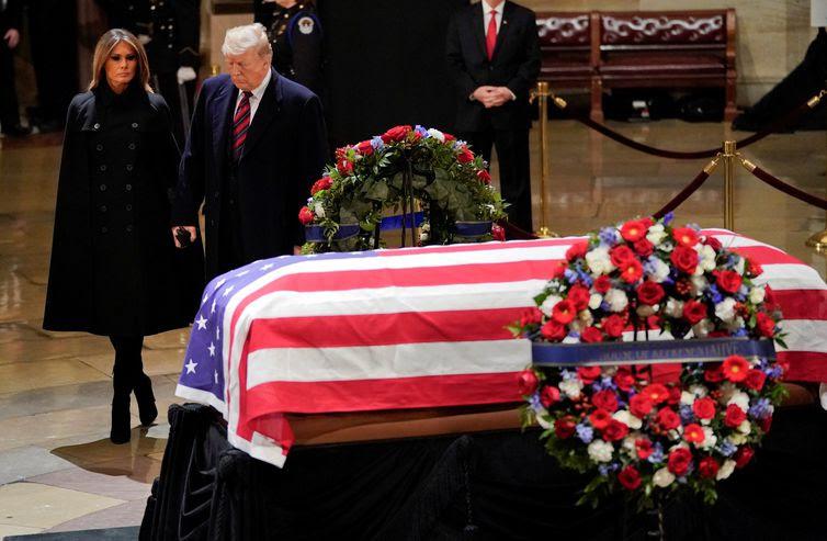 President Donald Trump and first lady George W. Bush, Velório Pablo Martinez Monsivais/Pool via REUTERS