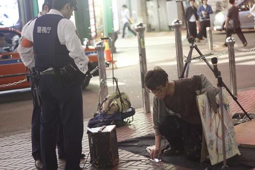 Cops approach Denis the tap dancing painter