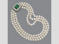 Cultured pearl necklace with emerald and diamond clasp The three strands composed of 41, 44 and