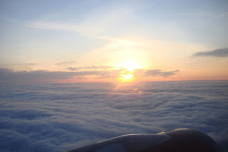 Sunrise - viewed out the window of bmi's BD79 - winging its way from Belfast City Airport to London Heathrow