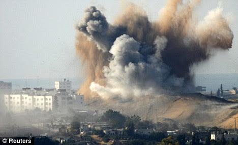 smoke rises after israeli air strike