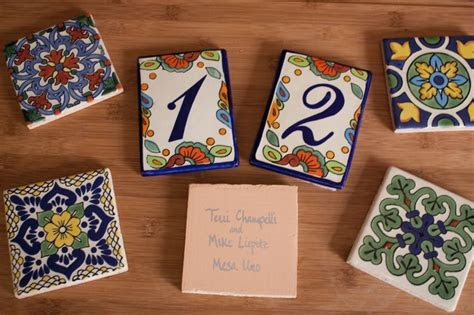 Mexican Talavera tiles as escort/place cards and favors