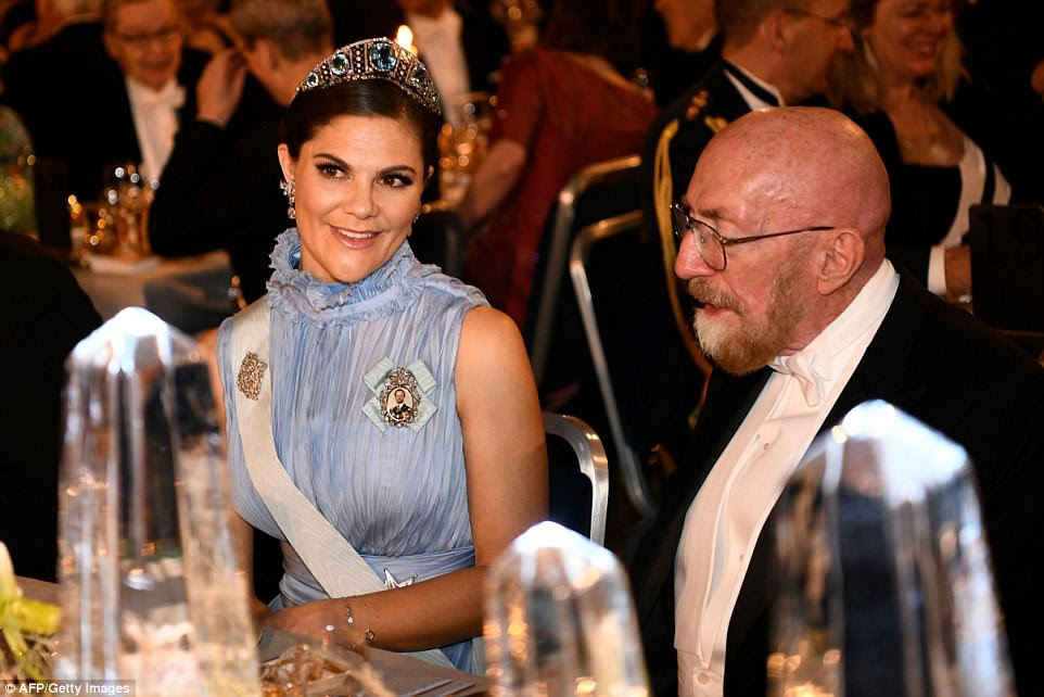 Sweden's Crown Princess Victoria and US physicist and Nobel Prize in Physics 2017 laureate Kip S. Thorn are pictured sat at the Table of Honour