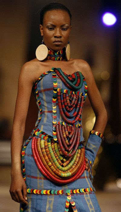love the use of the vulcanite beads/heishi (from the African trade period) that have been integrated into this dress by Nigerian designer Adegbe |  included in the 'Fashion for Peace' show in Nairobi