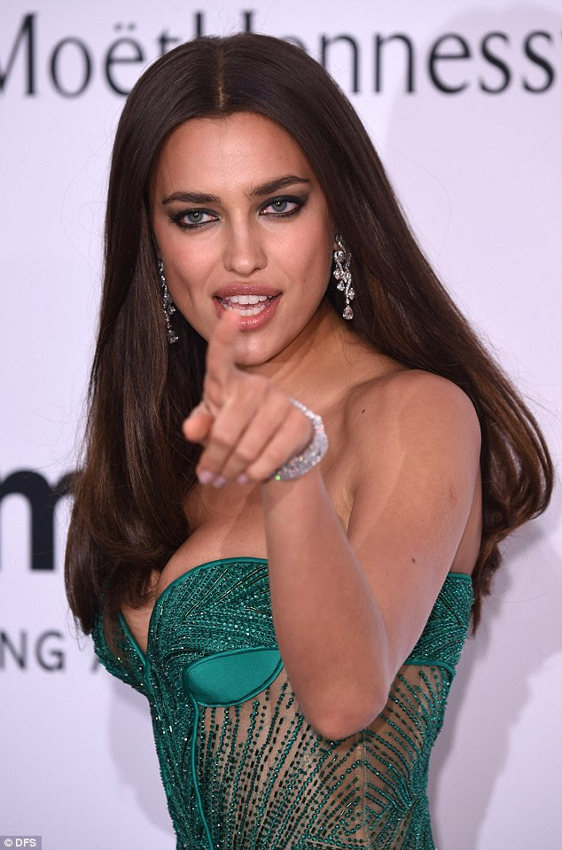 Attention to detail: Irina rounded off her glamorous proceedings with diamond encrusted earrings and a matching bracelet while keeping her brunette tresses loose in sleek waves