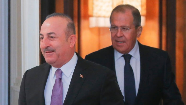 Turkish Foreign Minister Mevlut Cavusoglu (L) and Russian Foreign Minister Sergei Lavrov (R) enter a hall during their meeting in Moscow, Russia, 14 March 2018. EPA, MAXIM SHIPENKOV