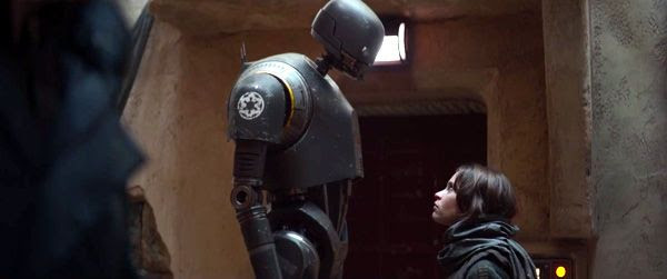 K-2SO (motion-captured by Alan Tudyk) confronts Jyn Erso on Jedha in ROGUE ONE: A STAR WARS STORY.