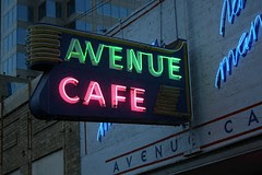 avenue cafe neon sign lit