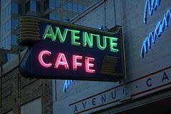 avenue cafe neon sign lit