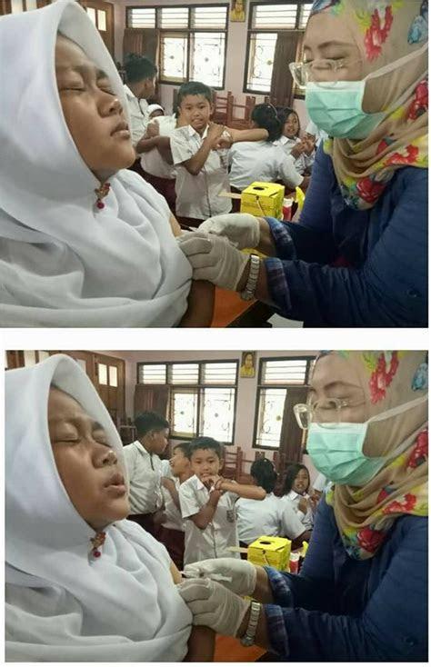 foto ekspresi anak sekolah disuntik imunisasi