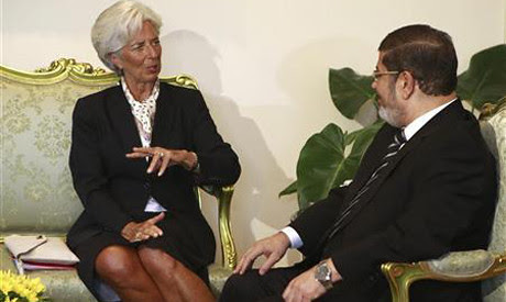 Egyptian President Mohamed Morsi with International Monetary Fund (IMF) managing director Christine Lagarde. Egypt is seeking a nearly $5 billion loan from the U.S.-based bank linked to ongoing neo-colonialism and underdevelopment within Africa. by Pan-African News Wire File Photos